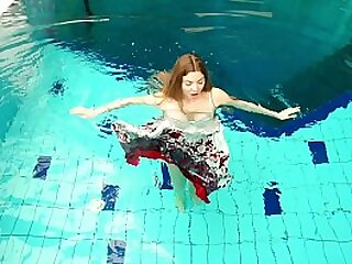 Sexy adolescence naked underwater swimming stripping